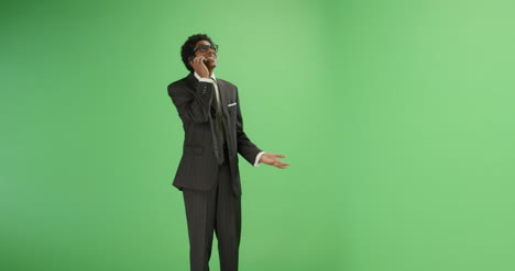Businessman-receives-good-news-on-phone-with-green-screen