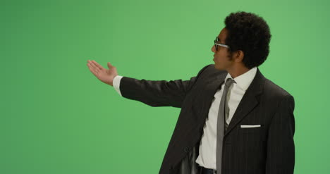 Businessman-gesturing-with-one-arm-on-green-screen