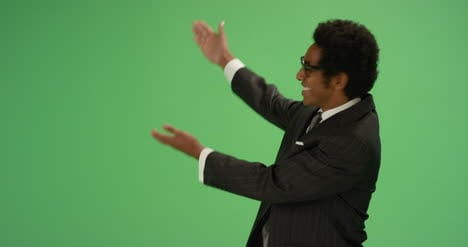 Happy-Businessman-gesturing-with-arms-on-green-screen