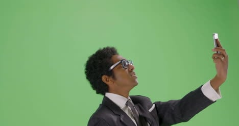 CU-Businessman-trying-find-phone-signal-on-green-screen