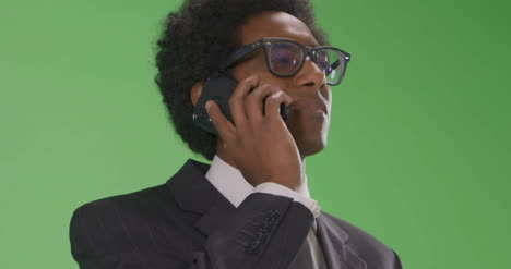 CU-Serious-Businesswoman-answer-phone-on-green-screen