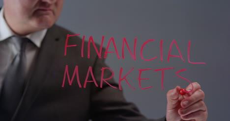 Geschäftsmann-Schreibt-Begriff-Finanzmärkte