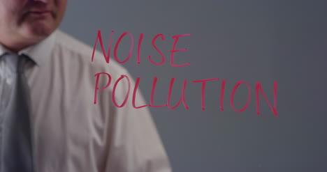 Man-Writing-Term-Noise-Pollution