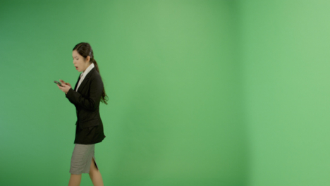 Annoyed-Woman-Texting-While-Walking-on-Green-Screen