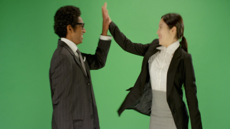 Man-and-Woman-in-Suits-Hi-Five