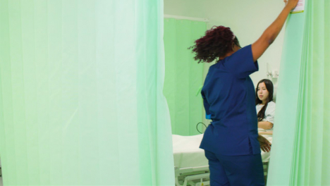 Nurse-Opens-Hospital-Curtain-in-Ward