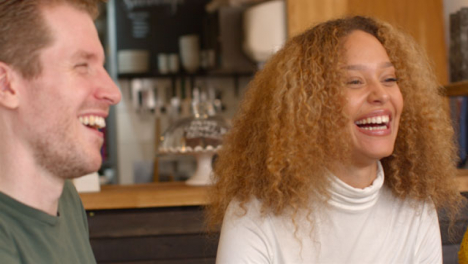Woman-Laughing-and-Joking-with-Friends