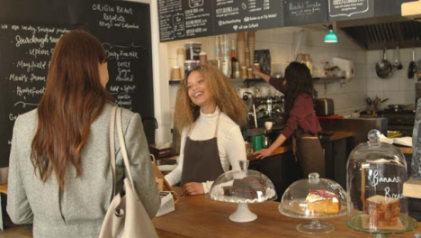 Woman-Walking-Up-to-Cafe-Counter