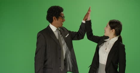 Man-and-Woman-in-Suits-Hi-Five-in-Slow-Motion