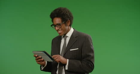 Businessman-Using-Tablet-While-Moving-on-Green-Screen