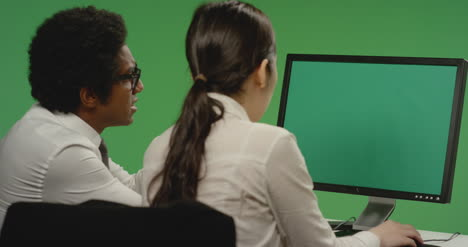 Colleagues-Look-Concerned-at-Computer-on-Green-Screen
