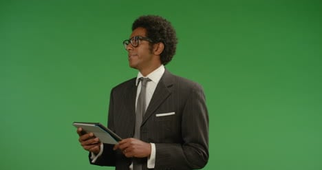 Annoyed-Businessman-Uses-Tablet-on-Green-Screen