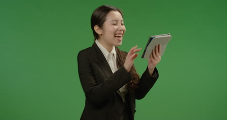 Laughing-Businesswoman-Uses-Tablet-on-Green-Screen