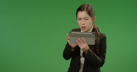Worried-Businesswoman-Uses-Tablet-on-Green-Screen