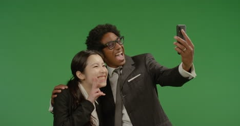 Smiling-Colleagues-Taking-Seflie-on-Green-Screen