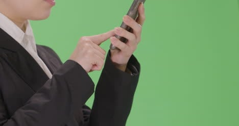 CU-Annoyed-Businesswoman-using-phone-with-green-screen