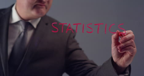 Businessman-Writing-Word-Statistics