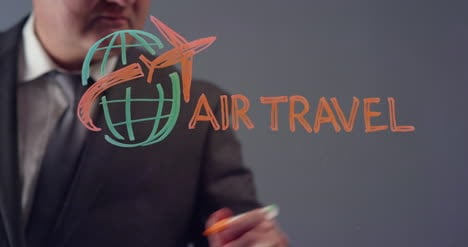Businessman-Drawing-Air-Travel-Symbol