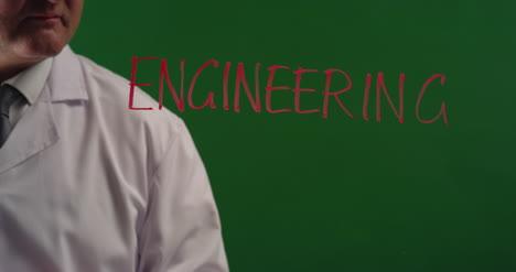 Man-Writing-Word-Engineering-On-Green-Screen