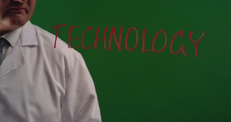 Man-Writing-Word-Technology-On-Green-Screen
