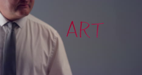 Hombre-escribiendo-la-palabra-arte