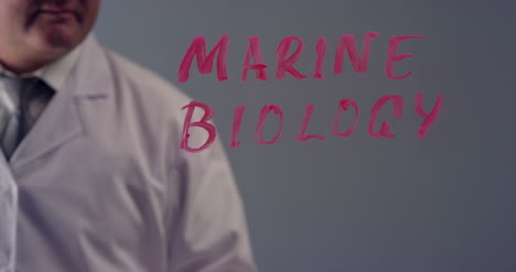 Scientist-Writing-the-Term-Marine-Biology
