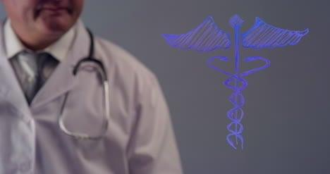 Doctor-Drawing-the-Symbol-for-Caduceus