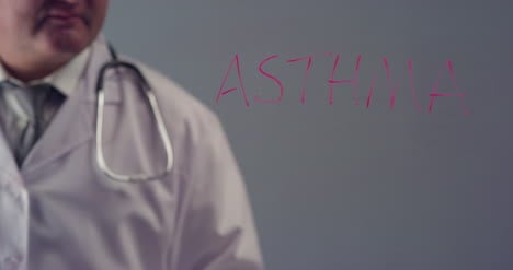 Doctor-Writing-the-Word-Asthma