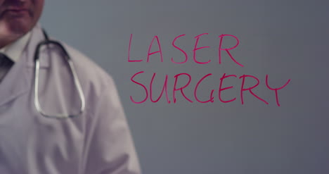 Doctor-Writing-the-Term-Laser-Surgery
