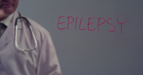 Doctor-Writing-the-Word-Epilepsy