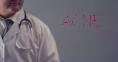 Doctor-Writing-the-Word-Acne