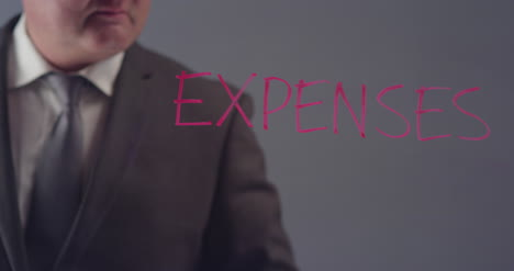 Businessman-Writing-Word-Expenses
