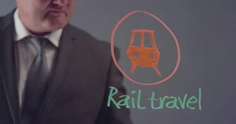 Businessman-Drawing-Rail-Travel-Symbol