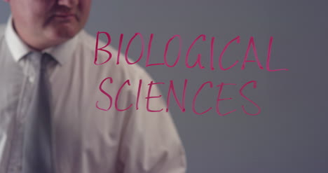 Man-Writing-Word-Biological-Sciences