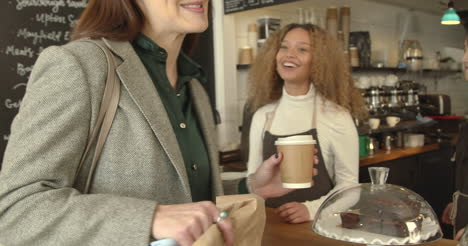 Woman-Pays-for-Take-Away-Coffee-Using-Smartphone