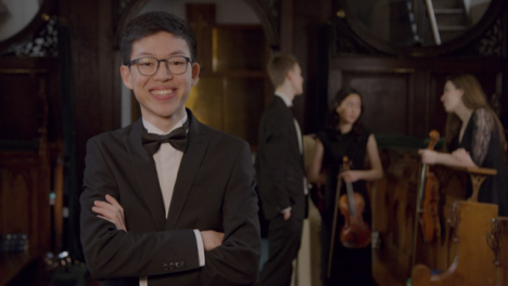 Male-Classical-Musician-Smiling-to-Camera