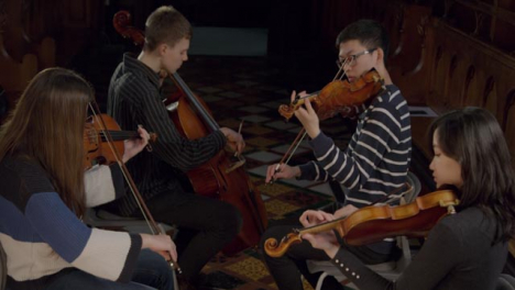 Looking-Down-at-String-Quartet-Playing-During-Performance