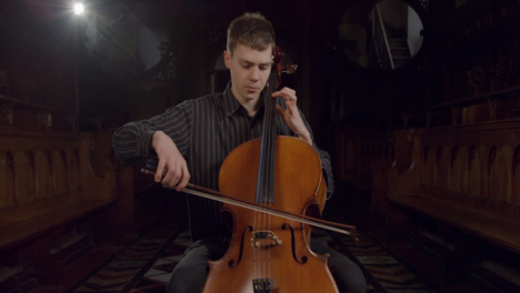 Front-View-Male-Cellist-Playing-During-Rehearsal