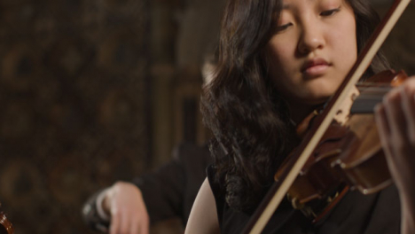 Pan-Up-To-Female-Violinist-During-Performance