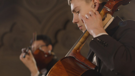 Cu-Male-Cellist-During-Performance-With-String-Quartet