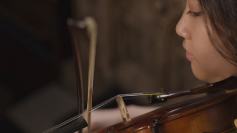 Close-Up-Of-A-Female-Violinist-During-Performance