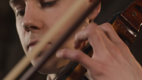 Pan-Down-Close-Up-Of-Male-Cellist-Plucking-Strings-On-Cello