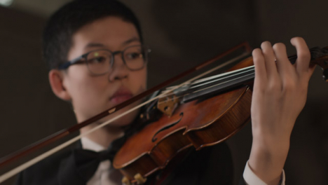 Camera-Move-From-Male-Violinist-To-Hands-Playing-Violin