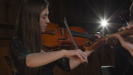 Pan-Shot-Female-Violinist-Plays-in-String-Quartet