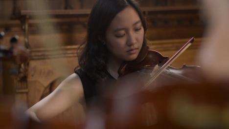 Female-Violinist-During-Recital-With-String-Quartet-