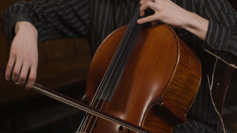 Tilt-Up-Close-Up-Male-Cellist-Playing