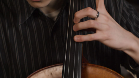 Close-Up-Of-Male-Cellist-Playing