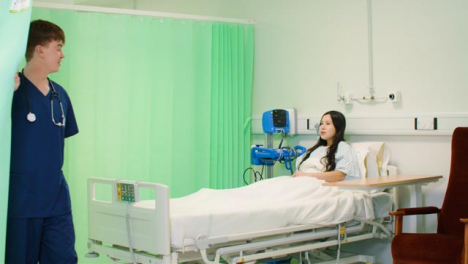 Male-Nurse-Screens-Hospital-Bed-With-Curtain
