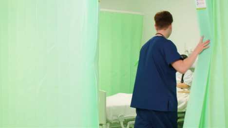 Male-Nurse-Opening-Hospital-Curtain