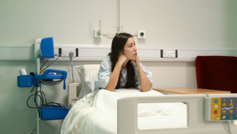 Patient-Sitting-in-Hospital-Bed